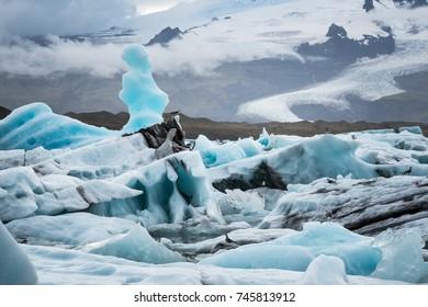 Jökulsárlón is a glacial lagoon, bordering Vatnajökull National Park in southeastern Iceland. Its still, blue waters are dotted with icebergs from the surrounding Breiðamerkurjökull Glacier.