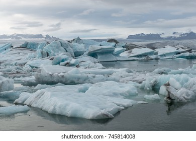 Jökulsárlón is a glacial lagoon, bordering Vatnajökull National Park in southeastern Iceland. Its still, blue waters are dotted with icebergs from the surrounding Breiðamerkurjökull Glacier.