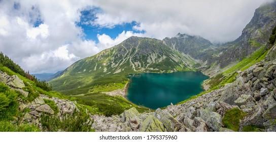 Glacial lake Czarny Staw Gasienicowy in Tatra mountains, Poland - Shutterstock ID 1795375960