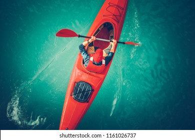 Glacial Lake Kayaking. Beautiful Turquoise Rock Flour Water Color and the Kayaker in the Red Kayak. Water Sports Theme. Aerial Photo.