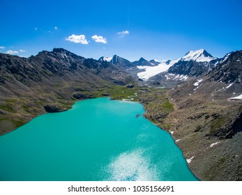 Glacial Mountain Lake with Aquamarine Blue Water and Clear Blue Sky