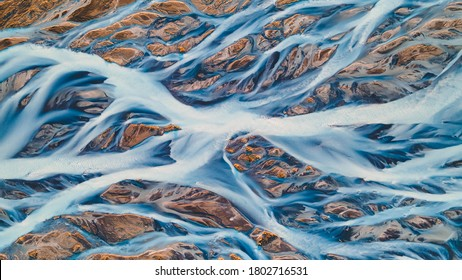 A glacial rivers from above. Aerial photograph of the river streams from Icelandic glaciers. Beautiful art of the Mother nature created in Iceland. Wallpaper background high quality photo - Shutterstock ID 1802716531