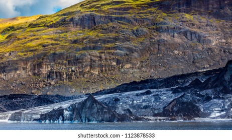 The glacial tongue where the ice falls and melts into the river at the foot of the Sólheimajökull outflow glacier. The glacier is shrinking at a rate of an Olympic swimming pool a year - August 2017