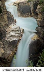 Glacial water tumbling down a waterfall in kootenay National park.
