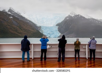 GLACIER ALLEY, BEAGLE CHANNEL, CHILE - DECEMBER 10: Passengers on board the cruise ship viewing beautiful Italia Glacier on Glacier Alley at December 10, 2012.
