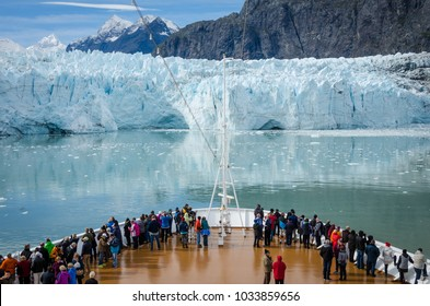 GLACIER BAY, ALASKA – SEPTEMBER 11, 2016: Cruise ship passengers get a close-up view of the majestic glaciers as they sail in Glacier Bay National Park and Preserve in Alaska.