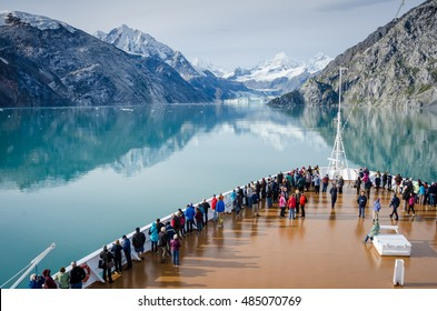 GLACIER BAY - ALASKA SEPTEMBER 11, 2016: Cruise ship passengers get a close-up view of the majestic glaciers as they sail in Glacier Bay National Park and Preserve in Southeast Alaska.