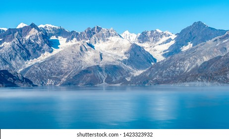 Glacier Bay National Park, Alaska. Spectacular sweeping vista of ice capped/ snow covered mountains, glaciers, wildlife landscape. Absolutely breathtaking natural untouched serene nature views.