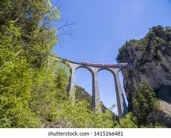 Glacier express on the Landwasser viaduct. Swiss Alps