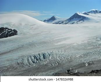 The Glacier of Harding Icefield with Deep Crevasses Covering Mountain Peaks in Kenai Fjords National Park near Seward, Alaska, USA, North America