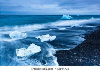 Glacier icebergs form abstract shapes in the ocean at Black diamond beach, Jokulsarlon, Iceland