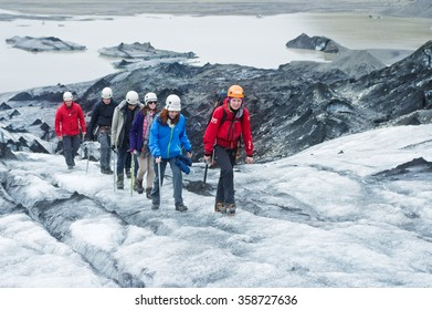 GLACIER, ICELAND - June 19: People hiking the Solheimajokull Glacier in Iceland on June 19, 2015.