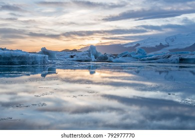 Glacier in Iceland with reflection on the water and sunset with red sky, Jokulsarlon, Iceland