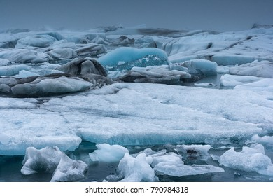 Glacier lagoon in south of Iceland with blue icebergs floating in the lake