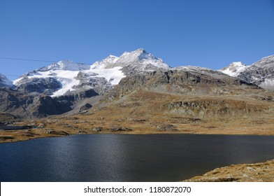 Glacier Lake Bianco in the Swiss Alps at the Bernina Hospitz, where you can see melting glaciers and permafrost