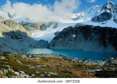 Glacier lake in the mountain in the early fall