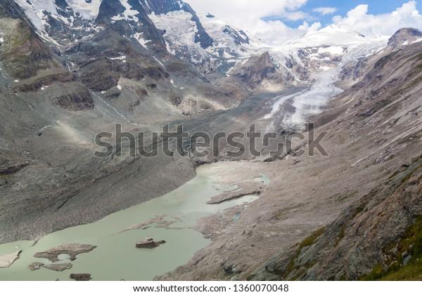 A glacier, a glacier lake and mountain range in Hohe Tauern National Park in Austria