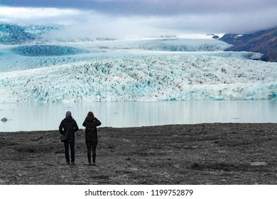 Glacier and lake with Tourists