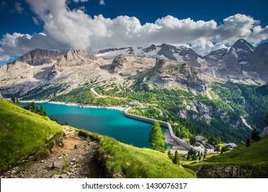 Glacier Marmolada, Italy - 8 7 2017: Blue lake under glacier Marmolada in Dolomites