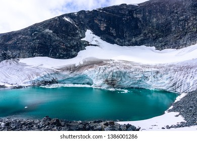 Glacier melting in Norway. Global warming effect on cold environment. Jotunheimen National Park. Glacial lake in front of glacier.