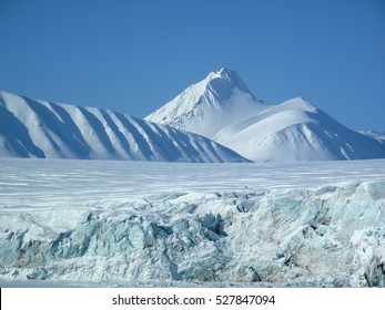 Glacier and mountains in the white land. Svalbard Islands