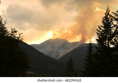 GLACIER NATIONAL PARK, BRITISH COLUMBIA, CANADA – JULY 19 2017: Forest fires caused by lightening burning on July 20th in the eastern side of Glacier National Park in British Columbia.