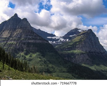 In Glacier National Park Montana the glacial hanging valley that feeds Bird Woman Falls is seen from Going-to-the-Sun Road under an autumn sky.