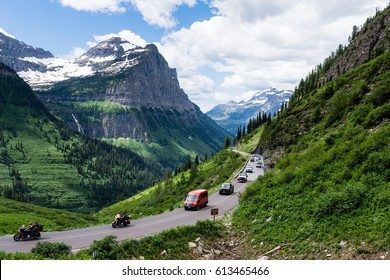 Glacier National Park, USA - July 4, 2016: Cars driving the crowded Going-to-the-Sun road on the 4th of July national holiday