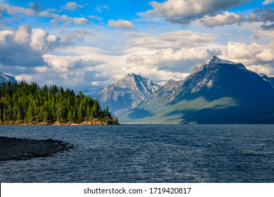 Glacier National Park's Lake McDonald in Montana, USA. Late afternoon in early September. View of Rocky Point, Mount Cannon, and Mount Brown from Fish Creek campground.