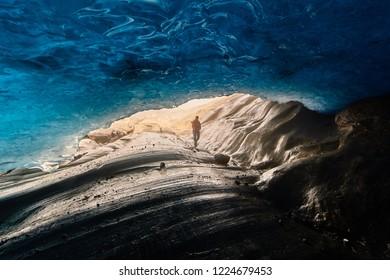 Glacier Svartisen, under a glacier, thawing of a glacier, blue deep color an arch from ice, Norway, rocks,  stones, nobody
