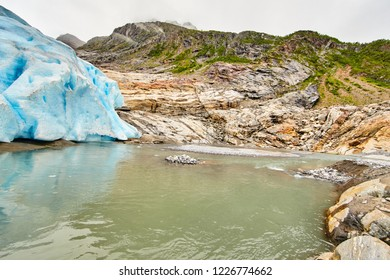 Glacier Svartisen, under a glacier, thawing of a glacier, blue deep color an arch from ice, Norway, rocks,  stones, nobody, Azur water,  lake,  calm