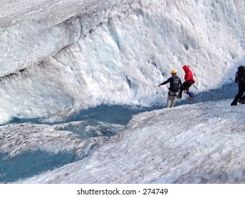 Glacier trekkers along a glacial stream on Mendenhall Glacier in Juneau, Alaska.