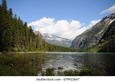 Glaciers and blue skies in background Avalanche Lake at Glacier National Park, Montana