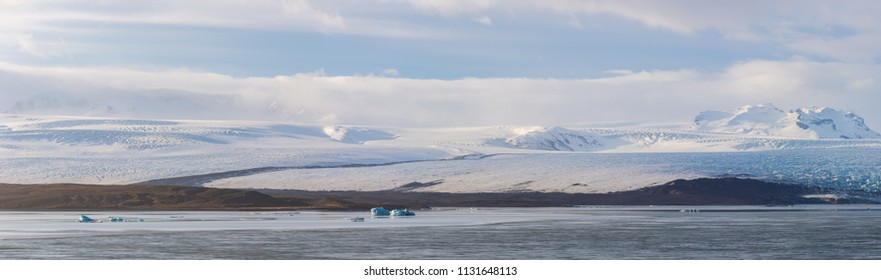Glaciers and iceberg panorama in jokulsalon lagoon Iceland