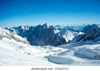The glaciers on top of Germany's tallest mountain, the Zugspitze, with the Zugspitz skiing resort on a beautiful cloudless winter morning, as seen from the Zugspitzplatt lift station.