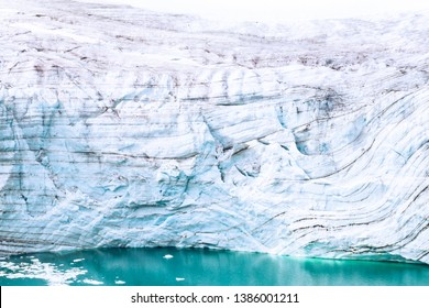 Glaciers of polar caps of the Earth. Ice Wall of sheet glacier (Ice front, zone of ablation), glaciology, glaciers study, climate change, ice melting. Franz Joseph Land, Rudolf island
