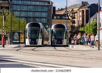 Glacis Square, Limpertsberg, Luxembourg - August 11, 2018: Two trams, on the newly opened city tram line, allow passengers to board and disembark at the Theater tram stop