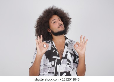 Glad attractive African American man shows ok sign with both hands as expresses approval, has cheerful expression. Photo of handsome male has appealing appearance, being optimistic.