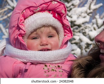 glad child together with mother