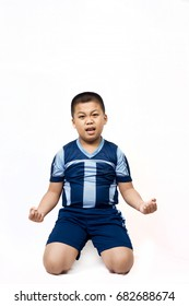 Glad kid football player after goal scored on white background.