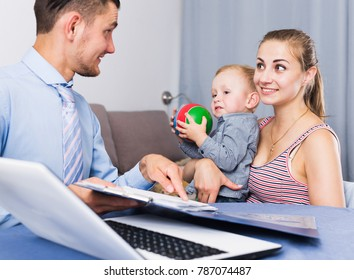 Glad worker conducting survey of population with young woman and son
