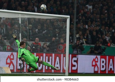 GLADBACH - MAR 21: Manuel Neuer saves a penalty during DFB Cup match between Borussia Gladbach & FC Bayern Munich, final score 2 - 4, on Mar 21, 2012, in Gladbach, Germany.