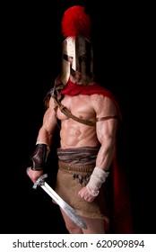 gladiator posing isolated in dark