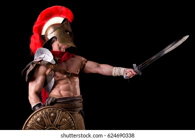 gladiator posing isolated in dark