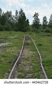 Gladkoye, Leningradskaya Oblast, Russia - June 25, 2016. Peat mining company narrow-gauge railway. Railway track near the company factory yard