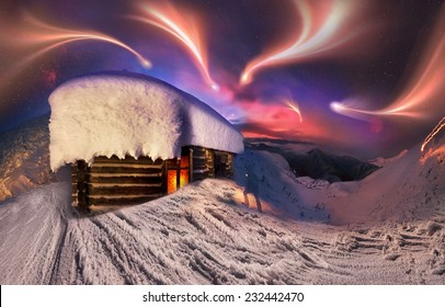 Gladly meet winter holidays in the mountains, on the background of blue mountains, red dawn, near the safe haven-alpine rescuers cabin atop Hoverla,  in the morning to climb to a height of Montenegro