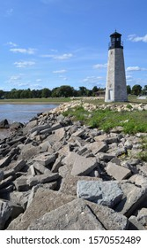 The Gladstone Lighthouse and harbor marker at Gladstone Michigan shown with the breakwater at the Little Bay De Noc north of Green Bay part of Great Lake Michigan on a sunny summer day.  - Shutterstock ID 1570552489