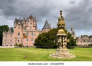 Glamis, Angus, Scotland, UK - June 18, 2018: Front lawn of Glamis Castle with wild Ring-necked Pheasant and The Great Sundial with 80 sundials on top and 4 held by Lions Scotland UK