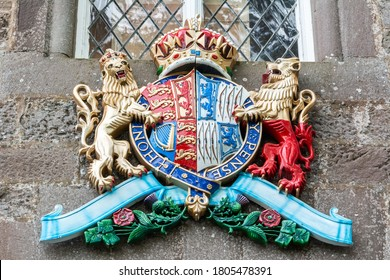 Glamis, Scotland, United Kingdom – September 11, 2017. The coat of arms of the late Queen Elizabeth the Queen Mother, at the entrance of Glamis Castle in Scotland.