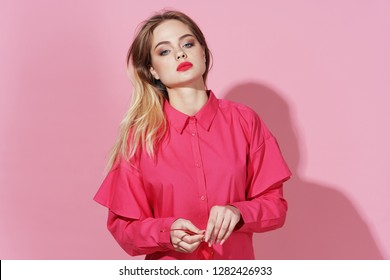 glamor beautiful woman with make-up on a pink background